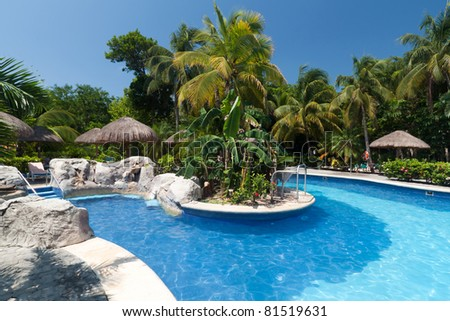 Tropical swimming pool side in Mexico