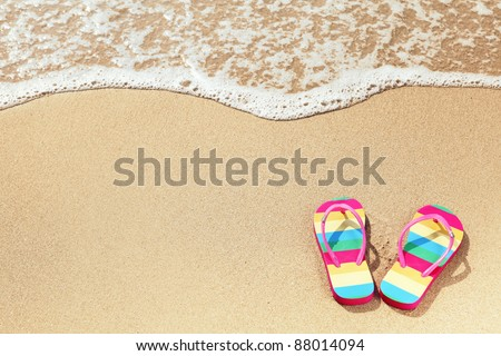 Tropical vacation concept--Flipflops on a sandy ocean beach #88014094