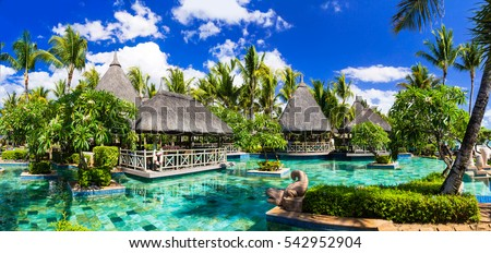 Tropical vacations. Luxury resort with swimming pool and lounge bar in Mauritius island. Flic en Flac beach
