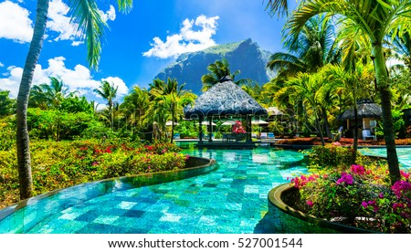 Tropical vacations - relaxing pool bar . Mauritius island #527001544