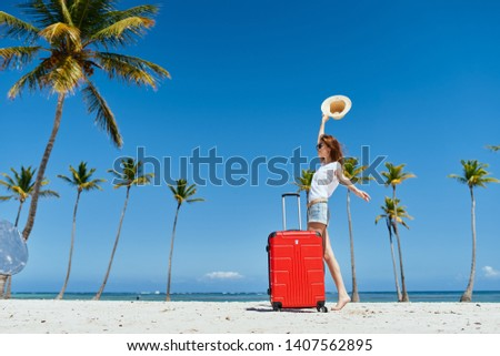 tropics heat summer vacation vacation woman with a suitcase on an island with palm trees                    #1407562895