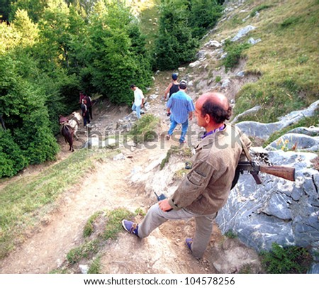 TROPOJE, KOSOVO, 19 JULY 1998 - A Kosovo Liberation Army (UCK) smuggler brings weapons across the border from neighboring Albania using horses.