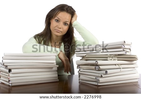 trouble woman in the office with heap of files