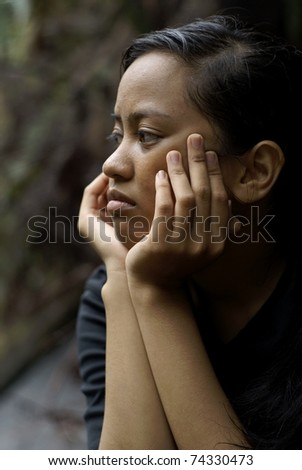 asian teen bikins stock photo : Troubled asian teen girl thinking with hands ...