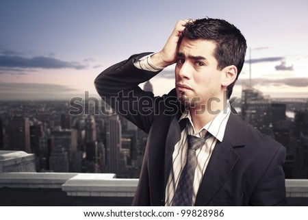 Troubled businessman on top of a building