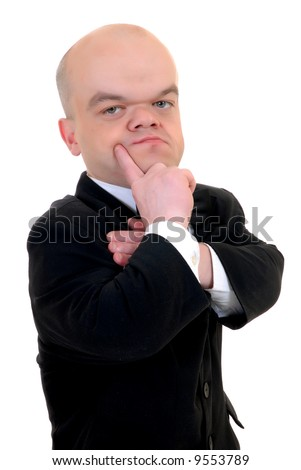 Troubled little businessman, dwarf in a formal suit with bow tie, studio shot, white background