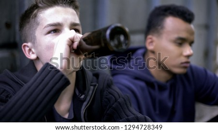 Troubled teenage friends skipping classes and drinking alcohol, youth problems
