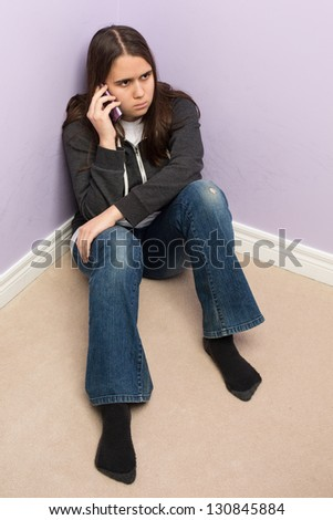 Troubled Teenage Girl Talking on Cell Phone