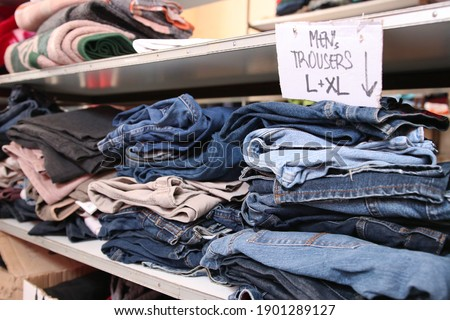 Trousers close up in a warehouse for refugees Stock photo ©