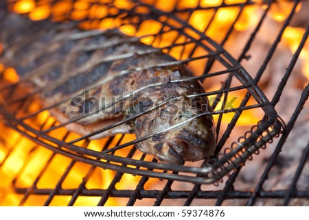 Trout cooking on a BBQ