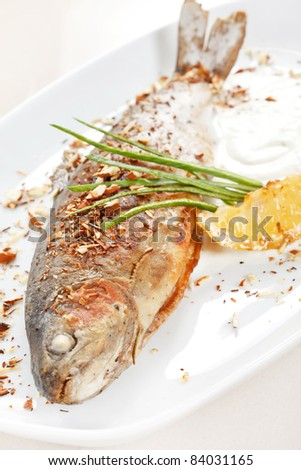 trout fish baked with nuts - stock photo