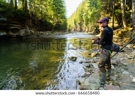 Trout fishing in the mountain river