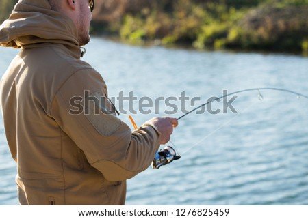 Trout fishing on the lake #1276825459