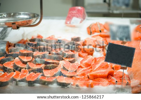 Trout slices on ice table in supermarket