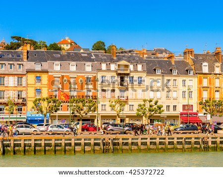 TROUVILLE, FRANCE - JUN 7, 2015:  Touques River and Trouville, Normandy, France. Trouville is a village of fishermen and a popular tourist attraction in Normandy #425372722