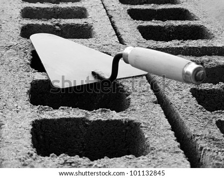 Trowel on a concrete blocks in black and white style