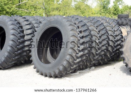 Truck and tractor tires for sale at a tire dealer.