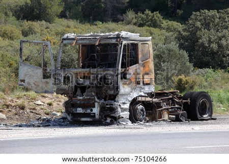 Truck burnt and abandoned along the road