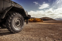 Truck car wheel on offroad steppe adventure trail