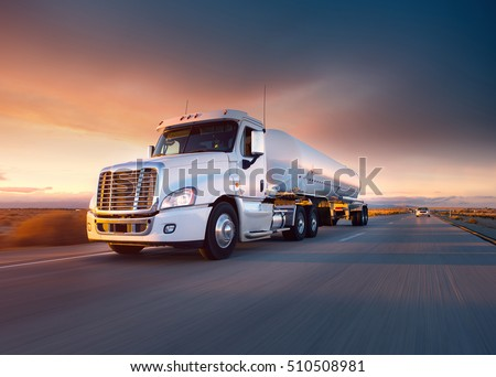 Truck cistern and highway at sunset - transportation background