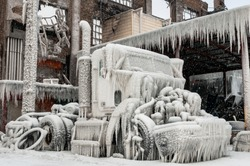 Truck covered in ice after firefighters fought the fire a very cold four days