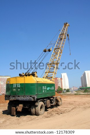 Truck crane on a building site of a new apartment house