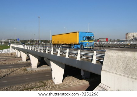 Truck crossing a highway overpass