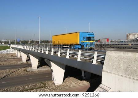 Truck crossing a highway overpass