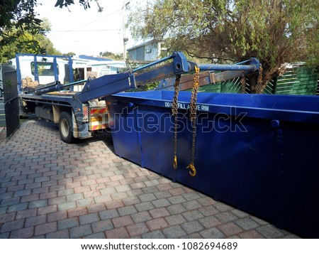 Truck delivering a empty waste skip