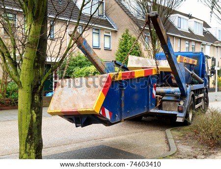 truck delivers waste container #74603410
