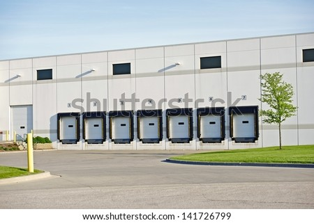 Truck Delivery Gates in the Warehouse. Business Park Photo. Business Photo Collection. - stock photo