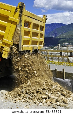 truck download inert material and stones for construction