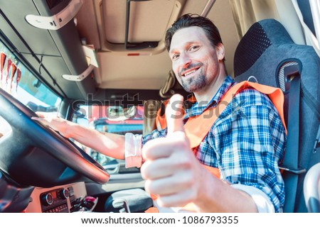 Truck driver man sitting in cabin giving thumbs-up  #1086793355