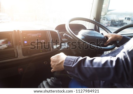 Truck driver,Truck driver keeps driving with hands. #1127984921
