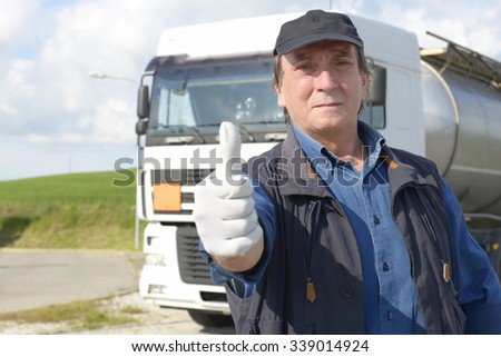 Truck driver with thumbs up