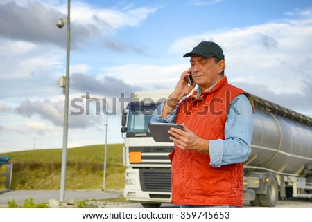 Truck driver working with tablet