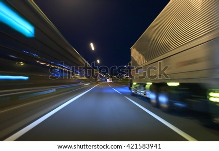 Truck driving on highway at night