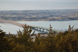 Truck driving over the Missouri River in South Dakota on a long bridge.