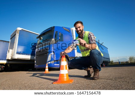 Truck driving school and CDL training. Driver candidate successfully finished truck driving training and acquired commercial driving license. Transportation business and learning to drive.