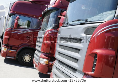 truck fleet, red new trucks after production