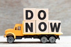 Truck hold letter block in word do now on wood background