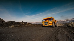 truck in an iron ore quarry transports raw materials. Industrial design. Web banner.