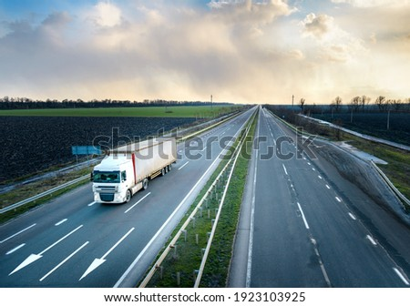 Truck in motion on highway, motion blur