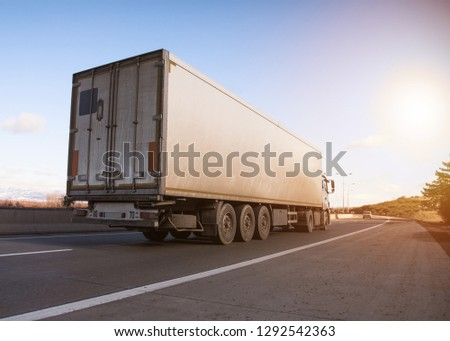 truck in road in sunset