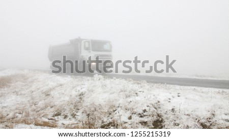Truck in the fog. Transport in all weather #1255215319
