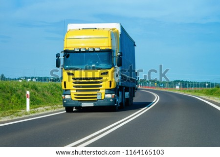 Truck in the highway in Poland. Lorry transport delivering some freight cargo.