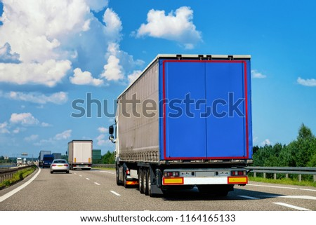 Truck in the road of Poland. Lorry transport delivering some freight cargo. #1164165133
