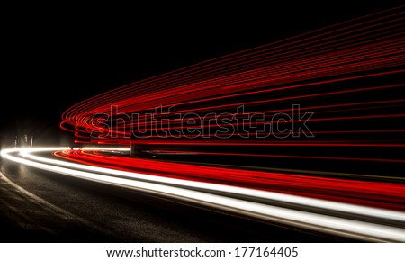 Truck light trails in tunnel. Art image . Long exposure photo taken in a tunnel