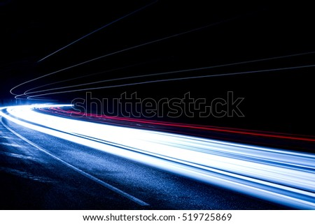 Truck light trails in tunnel. Art image . Long exposure photo taken in a tunnel  #519725869