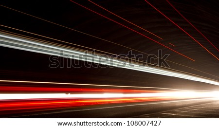 Truck light trails in tunnel. Art image . Long exposure photo taken in a tunnel. check my lightbox  http://www.shutterstock.com/lightboxes.mhtml?lightbox_id=12253330&from=lihp&pos=0 - stock photo